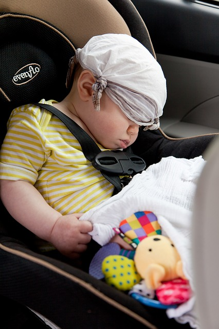 sleeping baby in the car seat